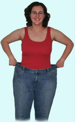 Susan showing her drop of 7 pants sizes after working with a personal fitness trainer